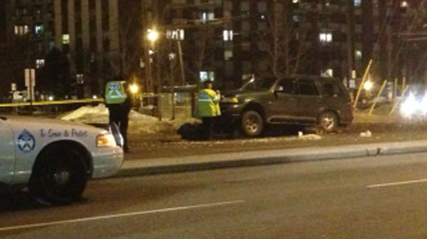 Police investigate after a 44-year-old woman was struck and pinned under a SUV at Midland and Eglinton avenues on Monday, Feb. 25, 2013. (CP24/Jackie Crandles)
