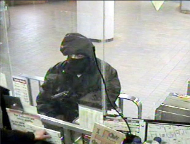 Toronto police released this surveillance image of a suspect wanted in the shooting of a TTC fare collector and two earlier robberies. (Handout)