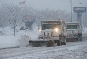 Snowplows clear a street in Lawrence, Kan., on Tuesday, Feb. 26, 2013. (AP Photo/Orlin Wagner)