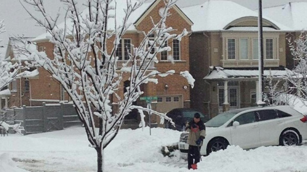 A man shovels his driveway in Richmond Hill after a snowstorm on Wednesday, Feb. 27, 2013. (Jessica Gorlicky/CP24.com)