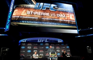 Welterweight UFC champion Georges St-Pierre, left, responds to a question as his opponent Nick Diaz, right, and UFC president Dana White listen during a news conference on Wednesday, Jan. 23, 2013 in Montreal. (The Canadian Press/Paul Chiasson)