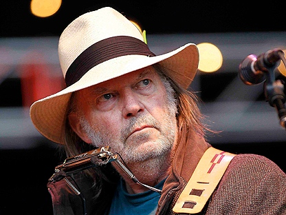 In this Oct. 24, 2010 file photo, Neil Young performs during the Bridge School Benefit concert in Mountain View, Calif.  (AP Photo/Tony Avelar, file)
