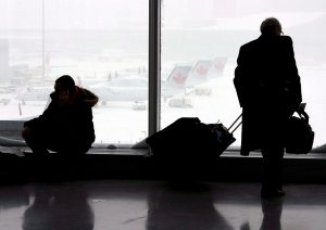Passengers wait at Pearson Airport in Toronto on Friday February 8, 2013. (Frank Gunn / THE CANADIAN PRESS)
