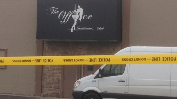 Police tape blocks off the entrance of The Office Gentleman's Club on March 13, 2013. (Cam Woolley/cp24)