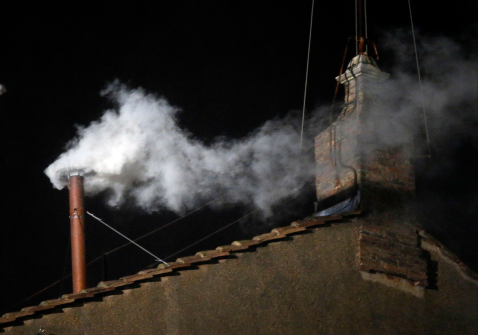 White smoke emerges from the chimney on the roof of the Sistine Chapel in St. Peter's Square at the Vatican on Wednesday, March 13, 2013. The white smoke indicates that a new pope has been elected. (AP Photo/Gregorio Borgia)