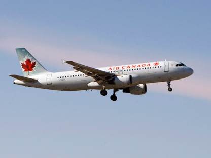 An Air Canada plane lands at Pearson Airport in Toronto on Friday Feb. 13, 2009. (THE CANADIAN PRESS/Frank Gunn)