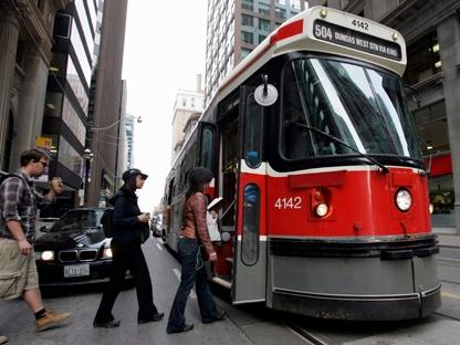 Passengers board a TTC streetcar in downtown Toronto. (THE CANADIAN PRESS/J.P. Moczulski)