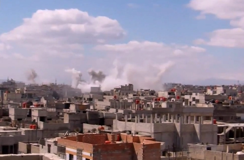 In this image taken from video obtained from the Shaam News Network, which has been authenticated based on its contents and other AP reporting, columns of smoke rise from heavy bombing by Syrian government forces in Arbeen, Syria, Monday March 18, 2013. (AP Photo/Shaam News Network via AP video)