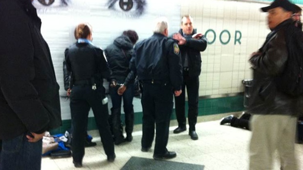 This picture submitted by a viewer shows police taking someone into custody at Bloor-Yonge Station, following a reported assault on a subway train on Monday, March 18. The TTC is apologizing to commuters after a number of subway delays during the evening rush hour Monday.