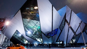 A long line of people wait in the cold outside the Royal Ontario Museum to attend its Friday Night Live event in Toronto on Friday, Nov. 30, 2012. (The Canadian Press/Michelle Siu)