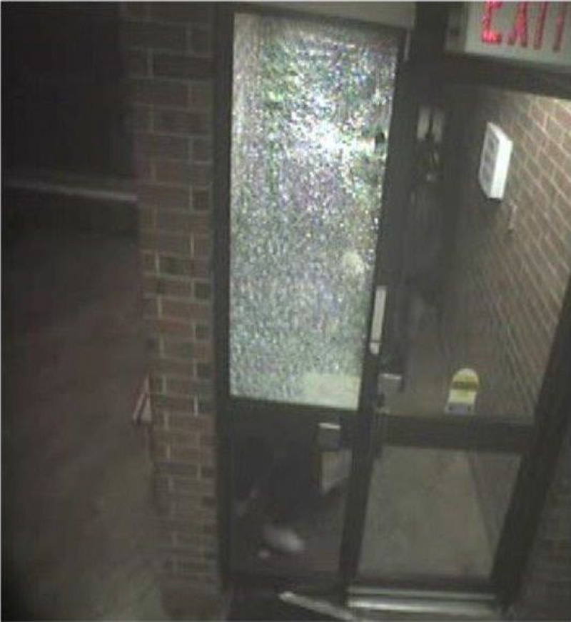 Toronto police released this image of a suspect, just to the right of the shattered window, in the shooting death of Nisan Nirmalendran. (Handout)