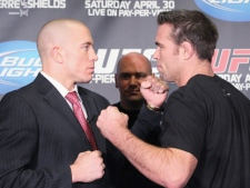 UFC 129 fighters Georges St-Pierre, left, and Jake Shields pose in front of UFC President Dana White at a news conference in Toronto on Tuesday, Feb. 8, 2011. St-Pierre will face Shields in the main event at UFC 129 in Toronto on April 30. (THE CANADIAN PRESS/Frank Gunn)