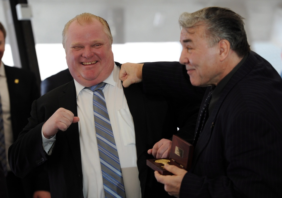 Toronto Mayor Rob Ford, left, hams it up with boxing great George Chuvalo after Chuvalo received the key to the city Tuesday, March 26, 2013. (The Canadian Press/Frank Gunn)