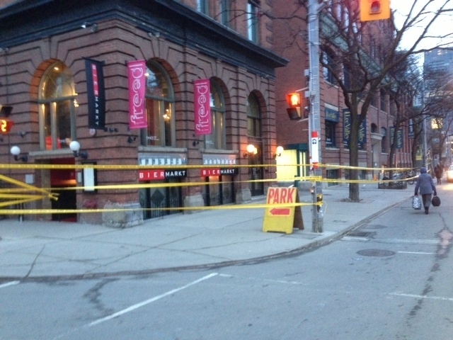 Police tape is shown at the scene of a shooting on King Street West at Portland Street on March 28, 2013. (Cam Woolley/CP24)
