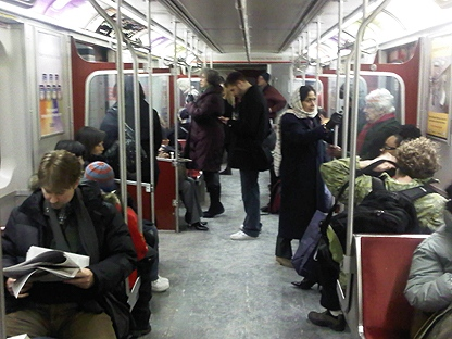 TTC passengers travel on a subway train. (CP24/Ken Enlow)