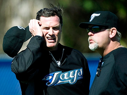 Toronto Blue Jays new Manager John Farrell, left, talks to Blue Jays pitching coach Bruce Walton, right, during spring training in Dunedin, FL, on Monday, Feb. 14, 2011. (THE CANADIAN PRESS/Nathan Denette)