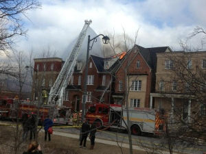 Firefighters battle a townhouse fire on Assiniboine Road, near Keele Street and Finch Avenue West, on Monday, April 1, 2013. (Photo courtesy of @saurabh_b90/Twitter)
