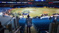 A Toronto Blue Jays fan wearing a jacket commemorating the club's last World Series takes his seat ahead of opening day baseball action against Cleveland Indians in Toronto on Tuesday, April 2, 2013. (Chris Young / THE CANADIAN PRESS)