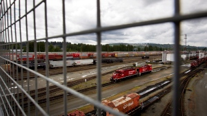 Canadian Pacific Rail locomotives and train cars sit idle at the company's Port Coquitlam yard east of Vancouver, B.C., on Wednesday, May 23, 2012. (Darryl Dyck / THE CANADIAN PRESS)