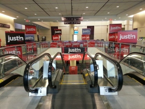 An escalator at the Metro Toronto Convention Centre stands plastered with banners for Liberal leadership candidate Justin Trudeau ahead of the Liberal Leadership National Showcase  Saturday, April 6, 2013. (CP24/ Sandie Benitah)