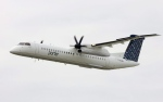 A Porter Airlines Bombardier Q400 turboprop does a fly by at the city centre airport in Toronto, in this Aug. 29, 2006 photo. (The Canadian Press/Adrian Wyld)
