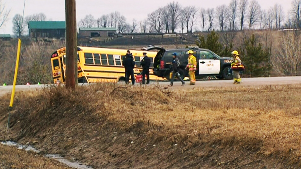 A school bus is seen on the side of the road after a crash near the intersection of Vasey and Old Fort roads, about 125 kilometres north of Toronto, on Tuesday, April 9, 2013.