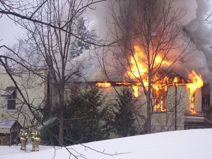 Firefighters battle a blaze at a historical building in the hamlet of Whitevale, Ont., on Thursday, Feb. 24, 2011. (Photo courtesy of Nicholas Schembri�)