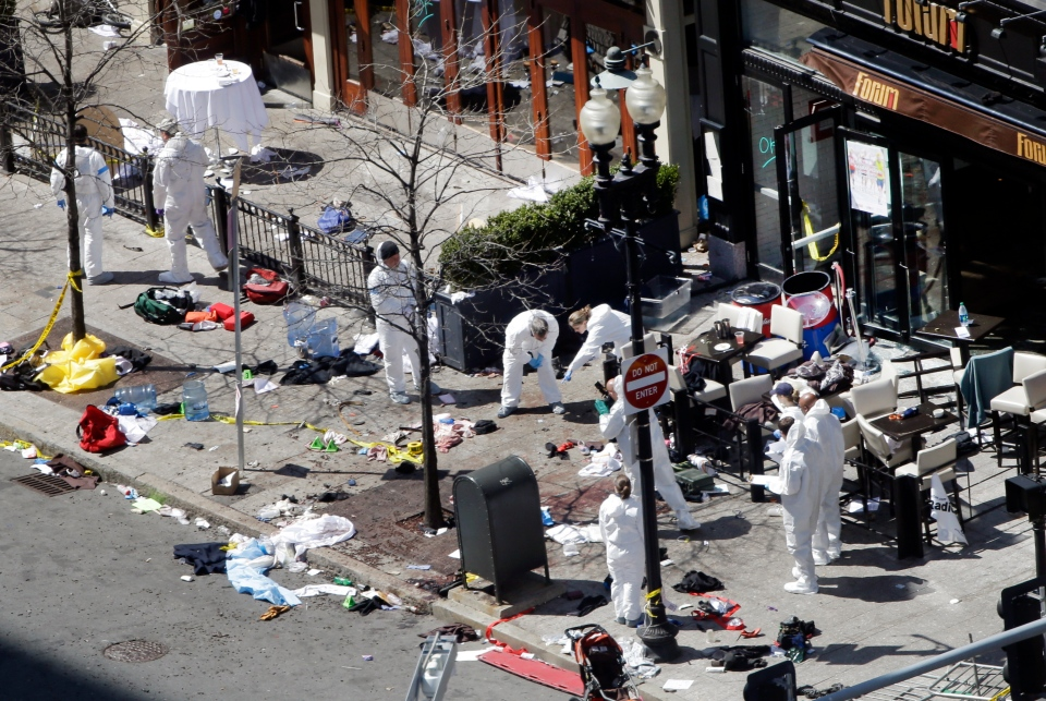 Investigators in haz-mat suits examine the scene of the second bombing on Boylston Street in Boston on Tuesday, April 16, 2013. (AP Photo/Elise Amendola)