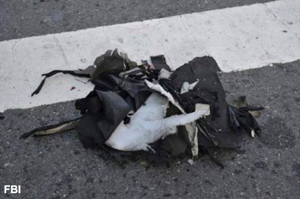 This image from a Federal Bureau of Investigation and Department of Homeland Security joint bulletin issued to law enforcement and obtained by The Associated Press, shows the remains of a black backpack that the FBI says contained one of the bombs that exploded during the Boston Marathon. (AP Photo/FBI)