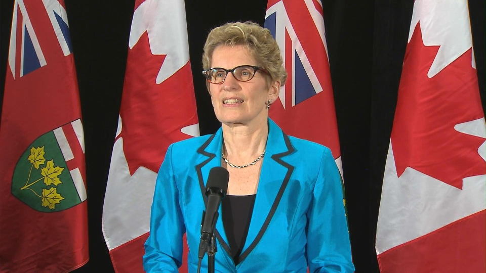 Premier Kathleen Wynne speaks to reporters Wednesday, April 17, 2013.