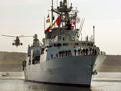 A Sea King helicopter escorts HMCS Charlottetown on the waterfront in Halifax on Wednesday, May 7, 2008, after it returned from a six-month tour of the Persian Gulf. The Canadian navy is sending HMCS Charlottetown to the waters off Libya. (THE CANADIAN PRESS/ Andrew Vaughan)