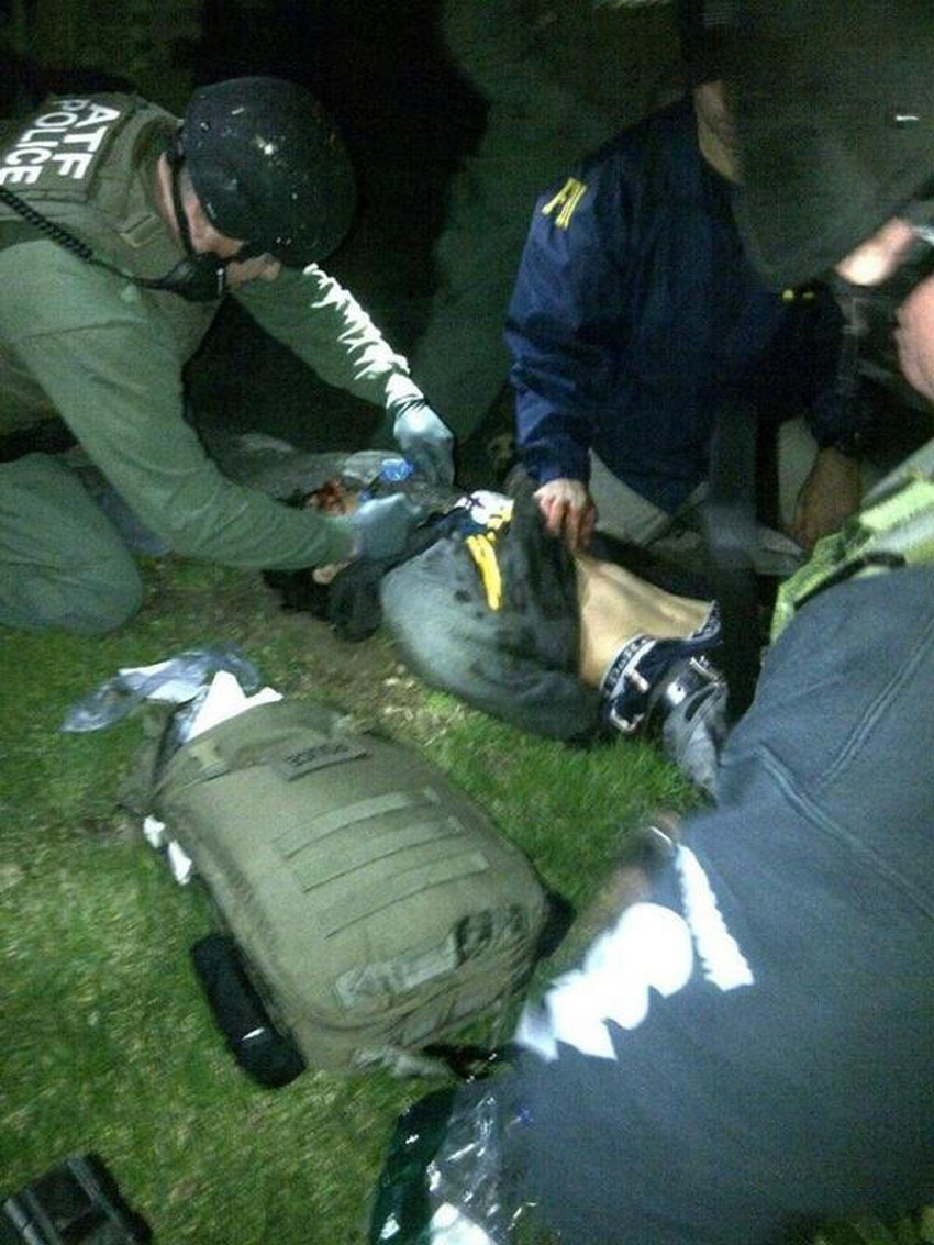 Authorities treat Boston Marathon bombing suspect Dzhokhar Tsarnaev after he was captured in a yard in Watertown, Mass., on Friday, April 19, 2013. (Reddit.com)