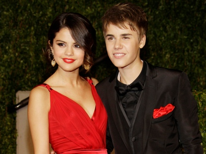 Justin Bieber and Selena Gomez arrive at the Vanity Fair Oscar Party at the Sunset Tower in Los Angeles, Calif., on Sunday, Feb. 27, 2011. (AP Photo/Carlo Allegri)