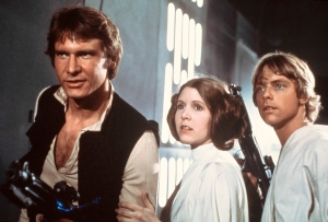 "This publicity film image provided by 20th Century-Fox Film Corporation shows, from left, Harrison Ford as Han Solo, Carrie Fisher as Princess Leia Organa and Mark Hamill as Luke Skywalker in a scene from ""Star Wars"" in 1977. (AP Photo/20th Century-Fox Film Corporation)"
