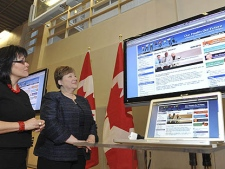 Federal Health Minister Leona Aglukkaq (left) and Nova Scotia Minister of Health and Wellness Maureen MacDonald view a demonstration of the online engagement site Our Health Our Future: A National Dialogue on Healthy Weights, Monday, March 7, 2010, in Toronto. (The Canadian Press Images PHOTO/Public Health Agency of Canada)