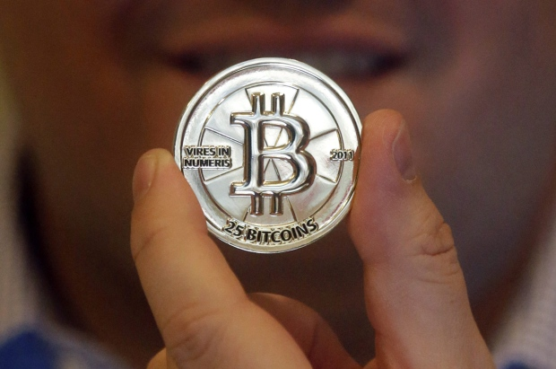 Digital currency dealers grapple financial rules