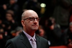 Director Steven Soderbergh arrives for the screening of the film Side Effects at the 63rd edition of the Berlinale, International Film Festival in Berlin, Tuesday, Feb. 12, 2013. (AP Photo/Gero Breloer)