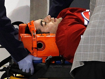 Montreal Canadiens' Max Pacioretty is wheeled away on a stretcher after taking a hit by Boston Bruins' Zdeno Chara during second period NHL hockey action Tuesday, March 8, 2011 in Montreal. Pacioretty has been diagnosed with a severe concussion and a fractured vertebra. (THE CANADIAN PRESS/Paul Chiasson)