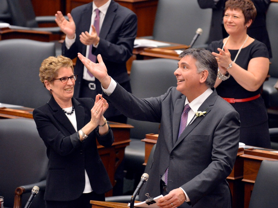 Ontario Premier Kathleen Wynne applauds as Finance Minister Charles Sousa tables the 2013 provincial budget at Queen's Park in Toronto on Thursday, May 2, 2013. (The Canadian Press/Nathan Denette)