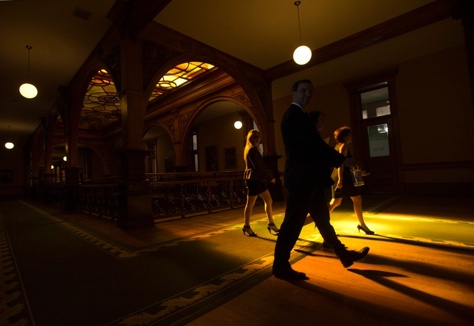 Ontario Conservative Leader Tim Hudak, centre, is silhouetted from the sun light as he makes his way to his office after Ontario Finance Minister Charles Sousa tabled the 2013 provincial budget at Queen's Park in Toronto on Thursday, May 2, 2013. (The Canadian Press/Nathan Denette)