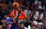 New York Knicks forward Carmelo Anthony (7) shoots over Boston Celtics forward Jeff Green during the second quarter in Game 6 of their first-round NBA basketball playoff series in Boston on Friday, May 3, 2013. (AP Photo/Charles Krupa)