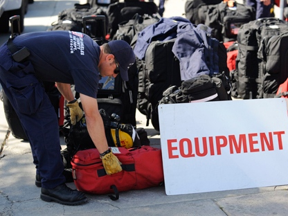 Members of the Los Angeles County urban search and rescue team prepare to deploy to Japan, Friday, March 11, 2011, in Los Angeles. (AP Photo/Gus Ruelas)