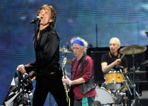 "Mick Jagger, left, Keith Richards, centre, and Charlie Watts of the Rolling Stones perform on the opening night of the band's ""50 and Counting"" tour at the Staples Center in Los Angeles on Friday, May 3, 2013. (Photo by Chris Pizzello/Invision/AP)"