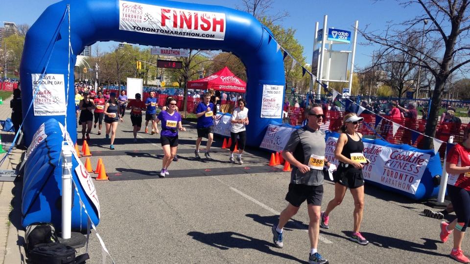 Marathon runners cross the finish line at the Goodlife Fitness Toronto Marathon on Sunday, May 5, 2013. (Ashley Rowe / CTV Toronto)