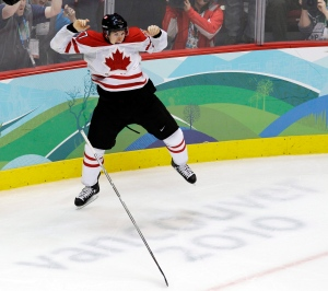 In this Feb. 28, 2010, file photo, Canada's Sidney Crosby (87) leaps in the air after making the winning goal in the overtime period of a men's gold medal ice hockey game against USA at the Vancouver 2010 Olympics in Vancouver, British Columbia. (AP Photo/Chris O'Meara, File)