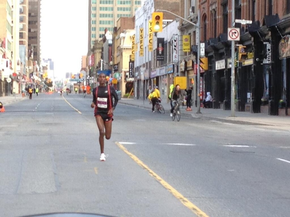 A runner takes part in the Sporting Life 10K race in Toronto on Sunday, May 12, 2013. (Jackie Crandles/CP24)