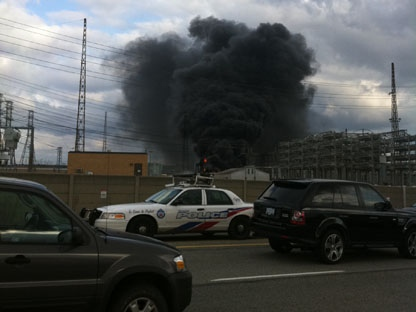 A cloud of smoke billows from a fire at a hydro station Friday, March 18, 2011. (CP24/Tom Podolec)