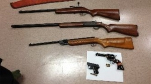 This photo from Toronto police shows firearms that they say were seized during a search of a home on Iangrove Terrance on Sunday, May 12, 2013. (Handout)