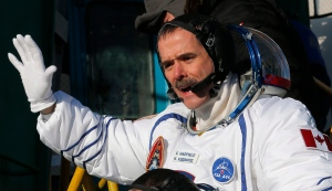 Canadian astronaut Chris Hadfield, a crew member of a mission to the International Space Station, gestures prior the launch of the Soyuz-FG rocket at the Russian-leased Baikonur cosmodrome in Kazakhstan, Wednesday, Dec. 19, 2012. (AP Photo/Dmitry Lovetsky, Pool)