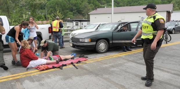 Up to 60 injured after car drives into Virginia parade